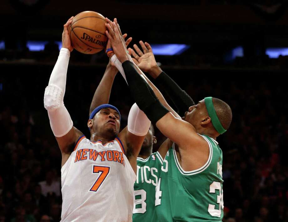 New York Knicks forward Carmelo Anthony (7) fends off Boston Celtics guard Jason Terry (8) and Celtics forward Paul Pierce, right, during the first half of Game 1 in the first round of the NBA basketball playoffs at Madison Square Garden in New York, Saturday, April 20, 2013.  (AP Photo/Kathy Willens) Photo: Kathy Willens, Associated Press / AP