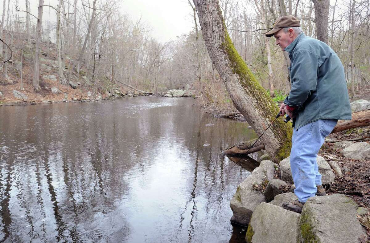 Arthur Fronio of Greenwich fishes the Minaus River in Greenwich, Saturday morning, April 20, 2013, during the first day of trout season.