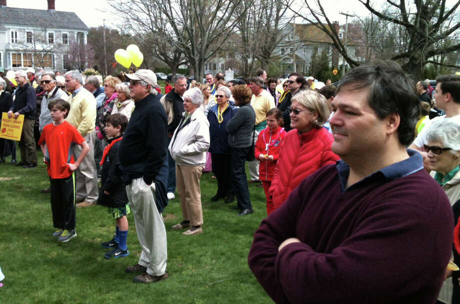 A crowd of about 200 people turned out Saturday at the Pequot Library for a rally calling for restoration of a $350,000 town allocation in the 2013-14 budget.   FAIRFIELD CITIZEN, CT 4/20/13 Photo: Andrew Brophy / Fairfield Citizen contributed