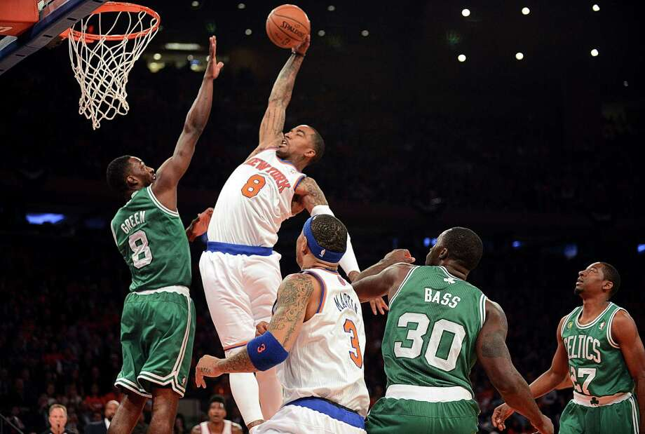 New York Knicks guard J.R. Smith (8) goes up for a a dunk over Boston Celtics forward Jeff Green (8) during Game 1 of their Eastern Conference playoff series at Madison Square Garden in New York, April 20, 2013. Photo: BARTON SILVERMAN, New York Times / NYTNS