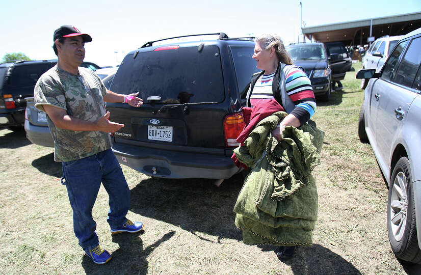 Pete Arias wonders if he can fit any more supplies in the back of their vehicle as his wife, Jacki,