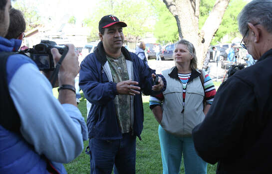 Pete (left) and Jacki Arias talk to reporters in front of the West, Texas City Hall on Saturday, Apr. 20, 2013. The Arias's home was less than a half-mile from the West Fertilizer Company explosion. Since Wednesday night, the family has stayed with a relative and have been frustrated by the lack of clear information on when they could return to their home. Photo: Kin Man Hui, San Antonio Express-News / ©2013 San Antonio Express-News