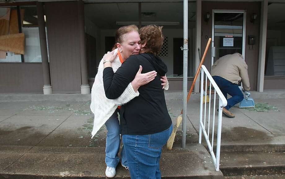 Kathy Green (left) hugs Libbie Veselka in front of Green's windowless retail center in downtown West, Texas, after the explosion that devastated the town. The names of the victims haven't been released. Photo: John Davenport, SAN ANTONIO EXPRESS-NEWS