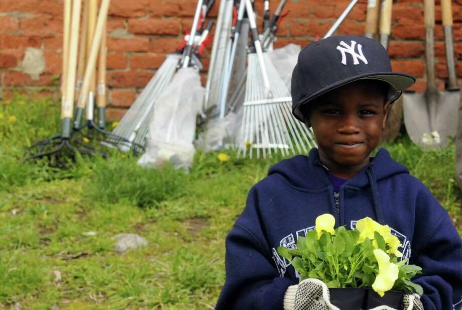 Eight-year-old Vincent Scott of Albany helps out with the third annual South End Earth Day at Elizabeth Street Park on Saturday April 20, 2013 in Albany, N.Y.(Michael P. Farrell/Times Union) Photo: Michael P. Farrell