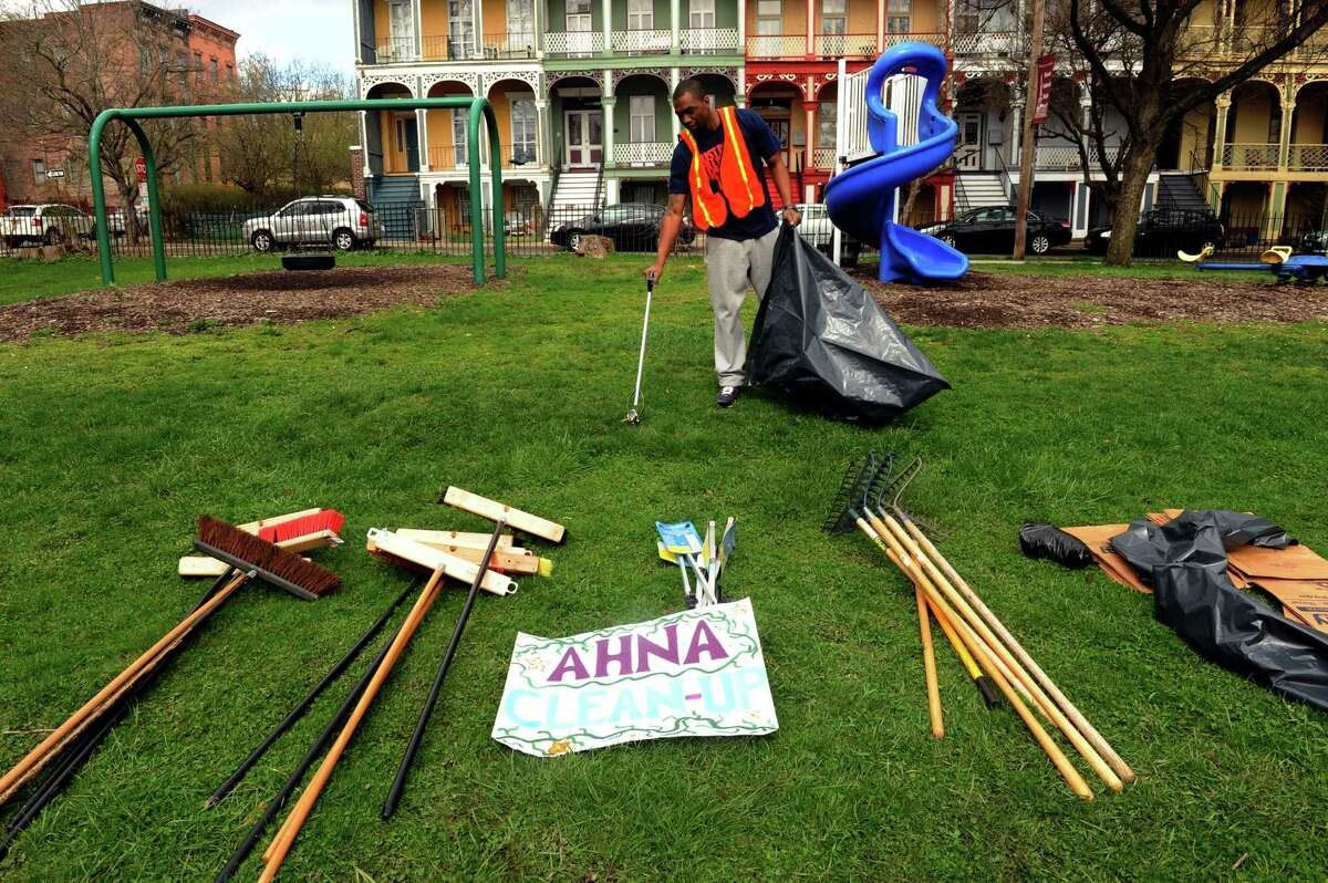 Jonathan Jones cleans up the grounds at Van Rensselaer Park during the Arbor Hill Neighborhood Association Earth Day celebration on Saturday April 20, 2013 in Albany, N.Y.(Michael P. Farrell/Times Union)