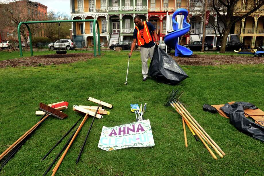 Jonathan Jones cleans up the grounds at Van Rensselaer Park during the Arbor Hill Neighborhood Association Earth Day celebration on Saturday April 20, 2013 in Albany, N.Y.(Michael P. Farrell/Times Union) Photo: Michael P. Farrell