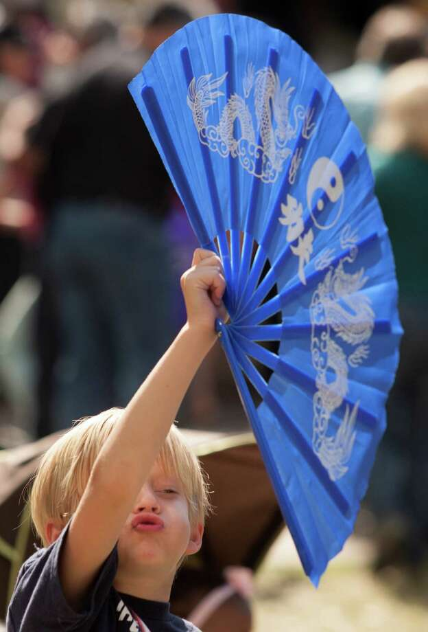Jonathon Clark, 6, waves his Japanese fan around during the 43rd annual Houston International Festival on Saturday, April 20, 2013, in Houston.  The highlight of the festival this year was the culture of South America with a focus on the art, music and cuisine of Brazil. Photo: J. Patric Schneider, For The Chronicle / © 2013 Houston Chronicle