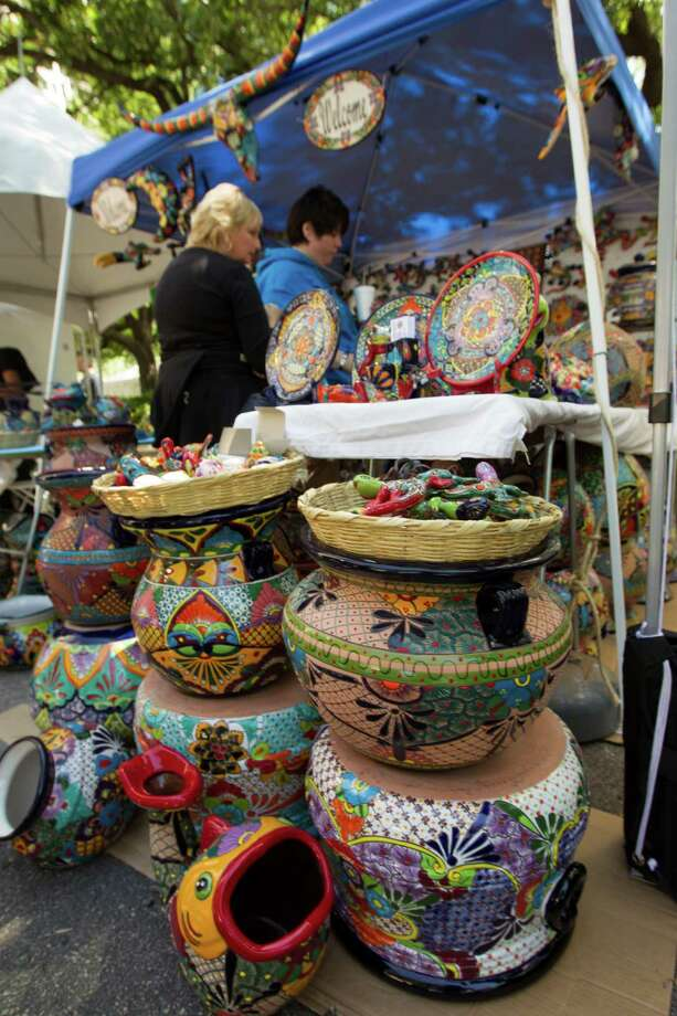 Customers look at pottery from Mexico during the 43rd annual Houston International Festival on Saturday, April 20, 2013, in Houston.  The highlight of the festival this year was the culture of South America with a focus on the art, music and cuisine of Brazil. Photo: J. Patric Schneider, For The Chronicle / © 2013 Houston Chronicle