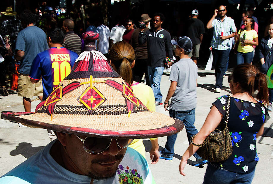 Jimmy Sosa wears an ethiopian hat as he walks around during the 43rd annual Houston International Festival on Saturday, April 20, 2013, in Houston.  The highlight of the festival this year was the culture of South America with a focus on the art, music and cuisine of Brazil. Photo: J. Patric Schneider, For The Chronicle / © 2013 Houston Chronicle