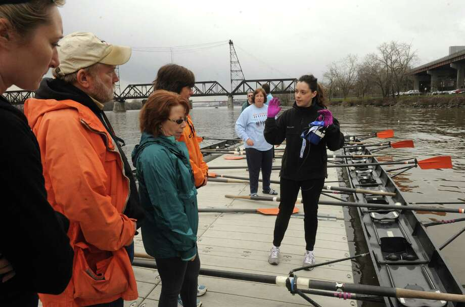Amanda Watkinson of the Albany Rowing Center works with beginning rowers during the Albany Rowing Center's Learn To Row Day on Saturday April 20, 2013 in Albany, N.Y. The event continues Sunday April 21, 2013 ? anytime between 9:00 am and 1:00 on - drop in participants.(Michael P. Farrell/Times Union) Photo: Michael P. Farrell