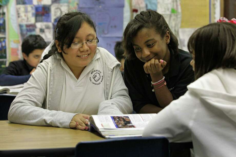 Gresia Nunez, 12,from  left, Brianna Ward, 12, and Patrice Stubblefield, 11, work in their sixth grade geography class at Wharton Dual Language Academy. Photo: Melissa Phillip, Staff / © 2013  Houston Chronicle