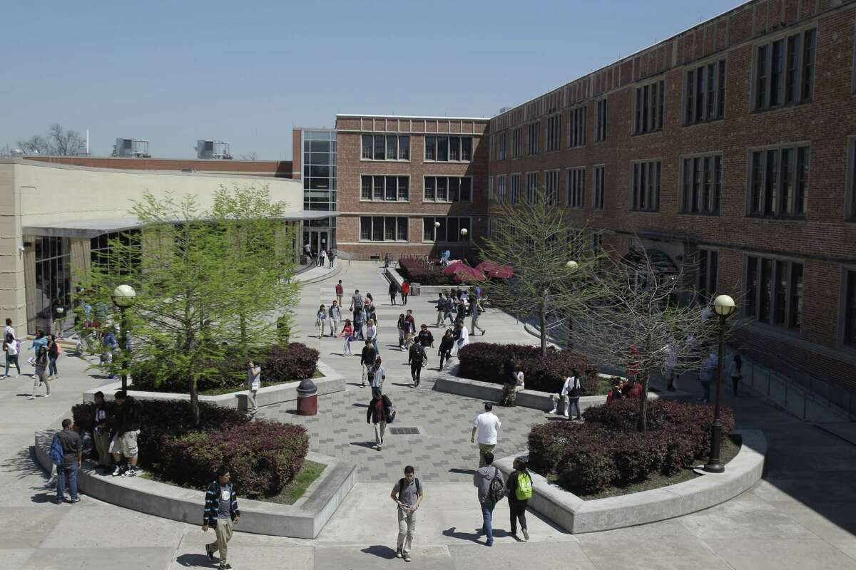 Reagan High students move through the courtyard to catch their next classes.