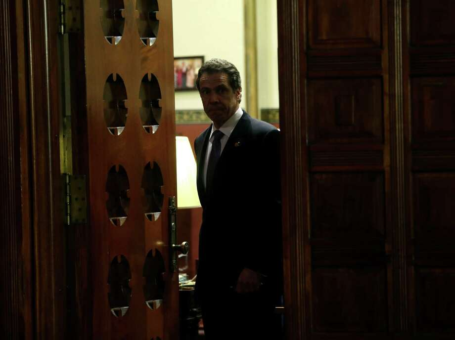 New York Gov. Andrew Cuomo arrives for a news conference in the Red Room at the Capitol on Tuesday, April 16, 2013, in Albany, N.Y. Cuomo is proposing a powerful new enforcement unit to crack down on campaign abuses and corruption.   (AP Photo/Mike Groll) Photo: Mike Groll, Associated Press / AP