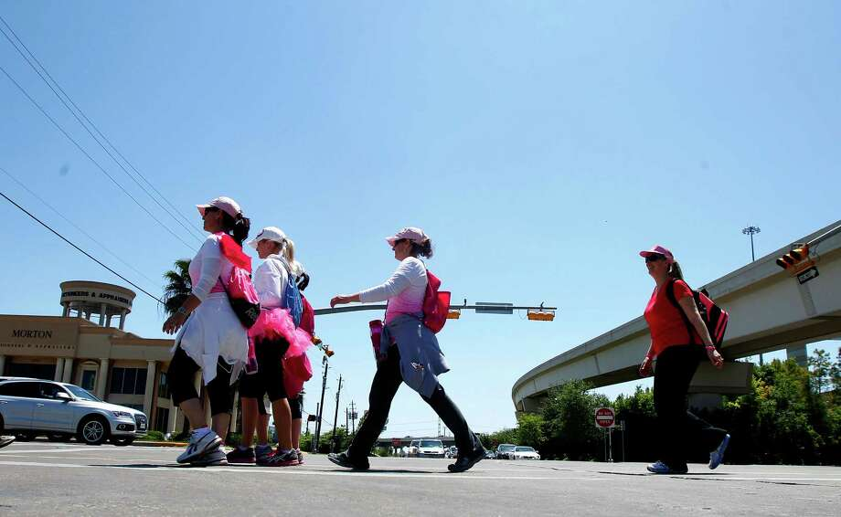 A group of walkers walk down Richmond Avenue during the 6th Annual Avon Walk for Breast Cancer Houston Saturday, April 20, 2013, in Houston. The walk consisted of a total of 39 miles split into two days. Photo: Cody Duty, Houston Chronicle / © 2013 Houston Chronicle