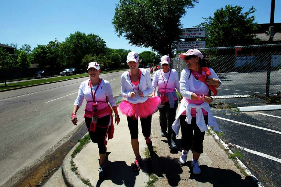 From left, Lisa Phillips, Sarah Judson, Wendy Wright, and Heidi Russell, walk along Richmond Avenue during the 6th Annual Avon Walk for Breast Cancer Houston Saturday, April 20, 2013, in Houston. The walk consisted of a total of 39 miles split into two days. Photo: Cody Duty, Houston Chronicle / © 2013 Houston Chronicle