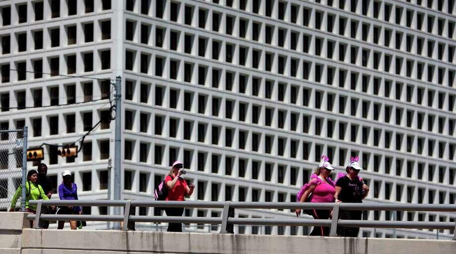 A group of walkers make their way over the Edloe Street bridge during the 6th Annual Avon Walk for Breast Cancer Houston Saturday, April 20, 2013, in Houston. The walk consisted of a total of 39 miles split into two days. Photo: Cody Duty, Houston Chronicle / © 2013 Houston Chronicle
