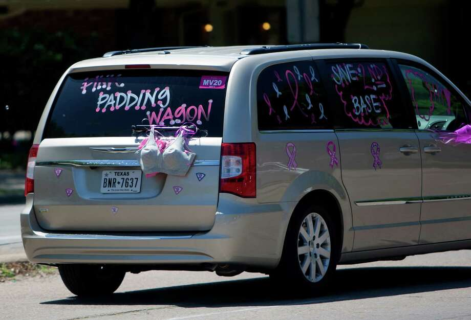 Support for breast cancer is seen on a van driving on Richmond Avenue during the 6th Annual Avon Walk for Breast Cancer Houston Saturday, April 20, 2013, in Houston. The walk consisted of a total of 39 miles split into two days. Photo: Cody Duty, Houston Chronicle / © 2013 Houston Chronicle