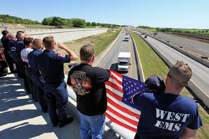 """First responders pay tribute, Saturday April 20, 2013, to fallen """"brothers"""" killed in an explosion at a fertilizer plant that occurred Wednesday evening in West, Tx. as their remains are driven to Dallas."""