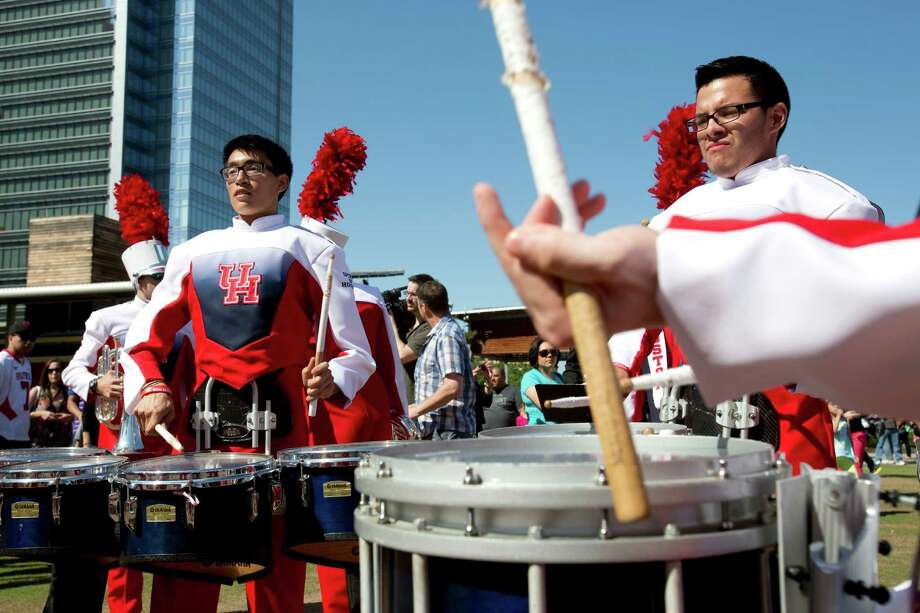 The University of Houston's Spirit of Houston Marching Band plays April 20, 2013 in Houston at Discovery Green. Photo: Eric Kayne, For The Chronicle / © 2013 Eric Kayne