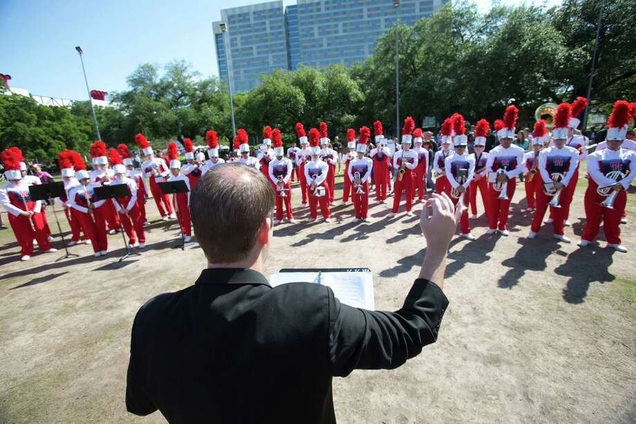 "The University of Houston's Spirit of Houston Marching Band plays April 20, 2013 in Houston at Discovery Green.They performed a work titled ""En Masse"" by composer Daniel Bernard Roumain, who is doing a two-year residency at UH's Mitchell Center for the Arts. Saturday's concert featured about 150 members of the band as well as Roumain, who plays the violin. Photo: Eric Kayne, For The Chronicle / © 2013 Eric Kayne"