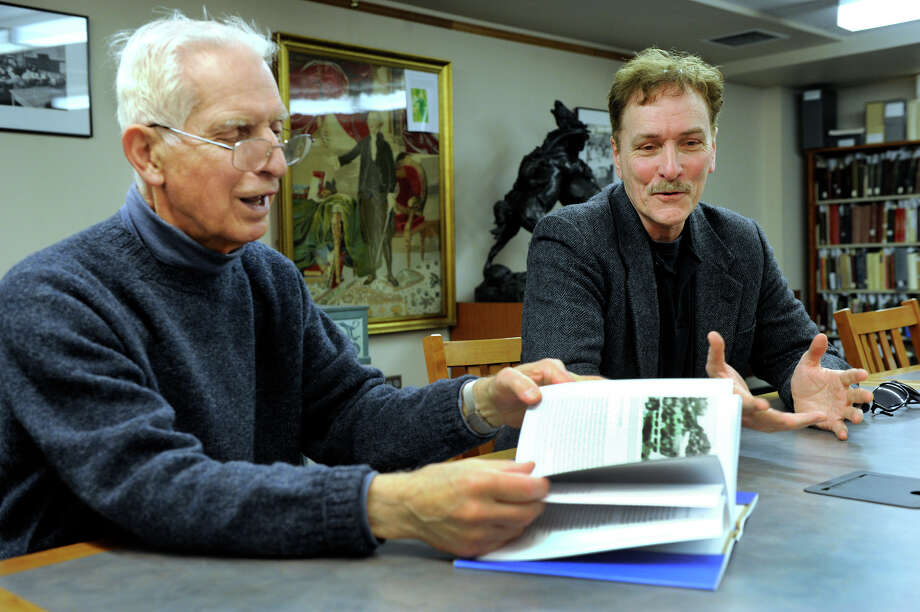 Herb Janick, left, and Bill Devlin talk about the new history book about  Danbury, Conn., that they have recently published, Tuesday, April 16, 2013. Photo: Carol Kaliff / The News-Times
