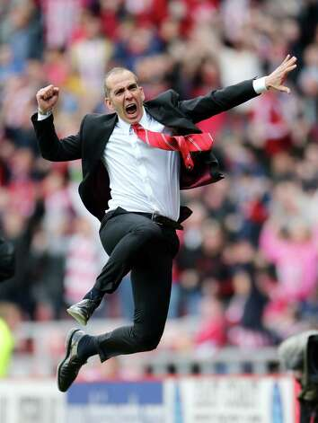 Sunderland's manager Paolo Di Canio, celebrates after defeating Everton at the end of their English Premier League soccer match at the Stadium of Light, Sunderland, England, Saturday, April 20, 2013. (AP Photo/Scott Heppell) Photo: Scott Heppell, Associated Press / AP