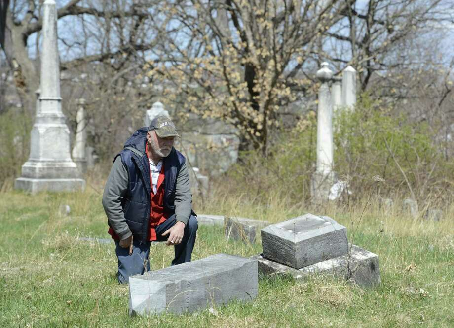 Caretaker Jim Doty looks over the damage at the Hudson View Cemetery which is partially in Mechanicville and Halfmoon, N.Y. April 2, 2012.  (Skip Dickstein/Times Union archive) Photo: Skip Dickstein