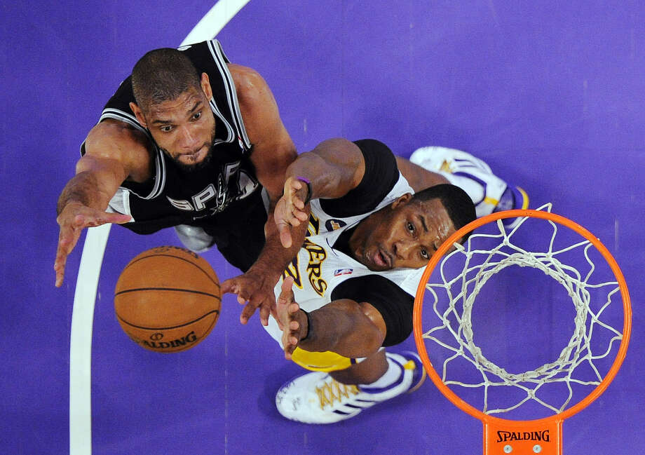 The Spurs would do well to get the ball to Tim Duncan (left) quickly before Dwight Howard can set up. Photo: Mark J. Terrill / Associated Press