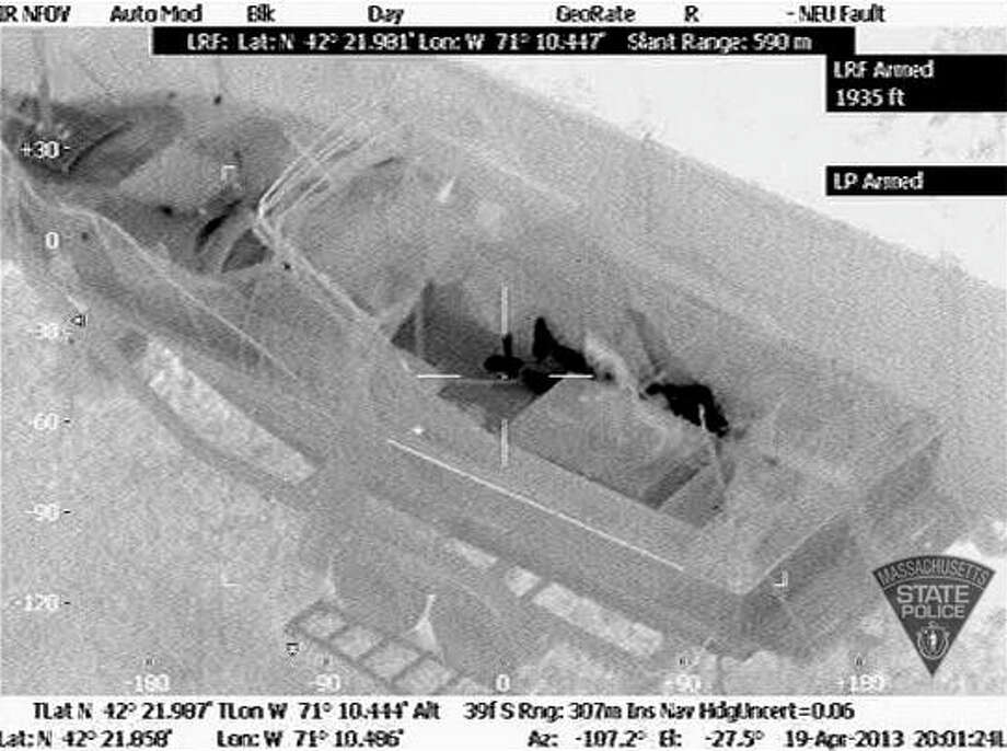 This Friday, April 19, 2013 image made available by the Massachusetts State Police shows Dzhokhar Tsarnaev hiding inside a boat during a search for him in Watertown, Mass. (AP Photo/Massachusetts State Police). Photo: HOPD / Massachusetts State Police