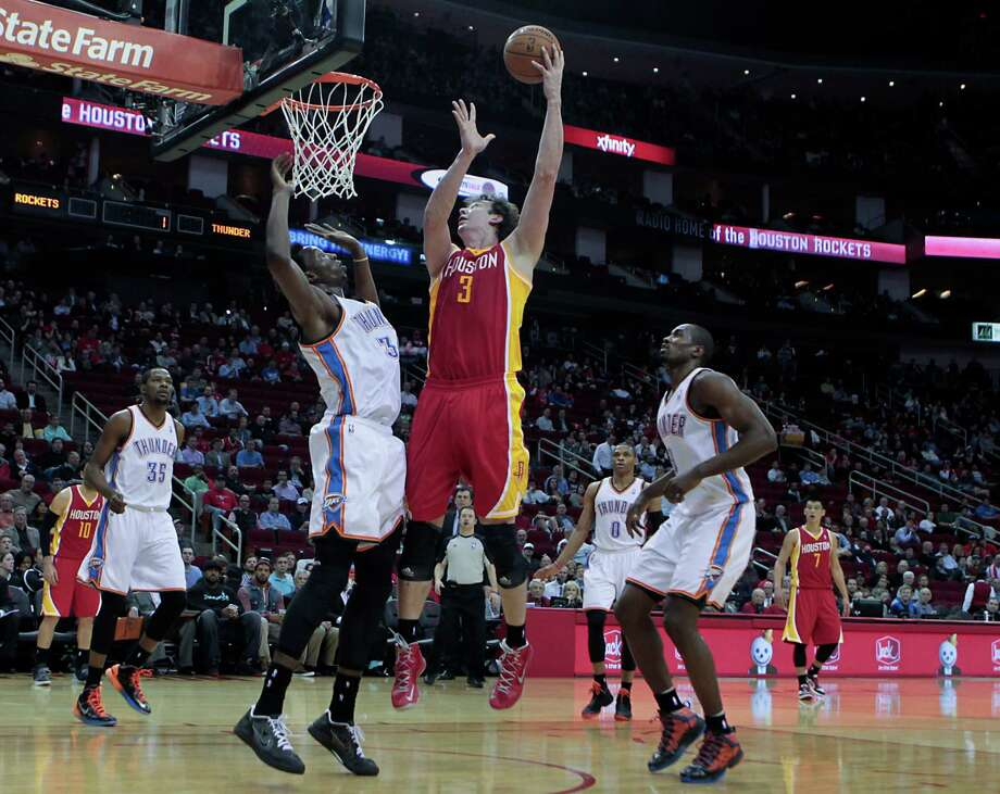 Omer Asik's ability to rebound has become vital to the Rockets, who would like to see him score more as well. Photo: James Nielsen, Staff / © 2013  Houston Chronicle