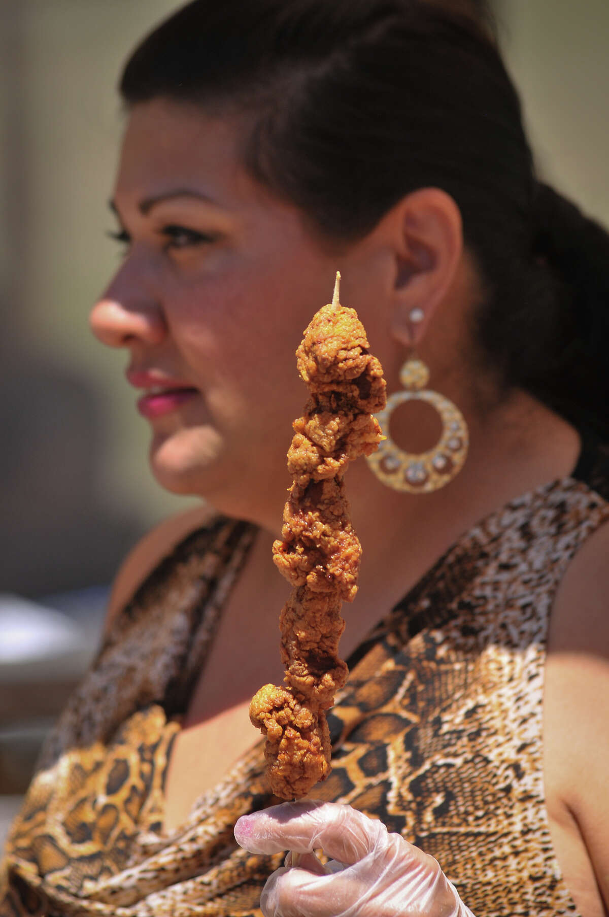 2. Flashy types wear alligator boots, but we prefer alligator-on-a-stick, a Fiesta dare at Taste of New Orleans.