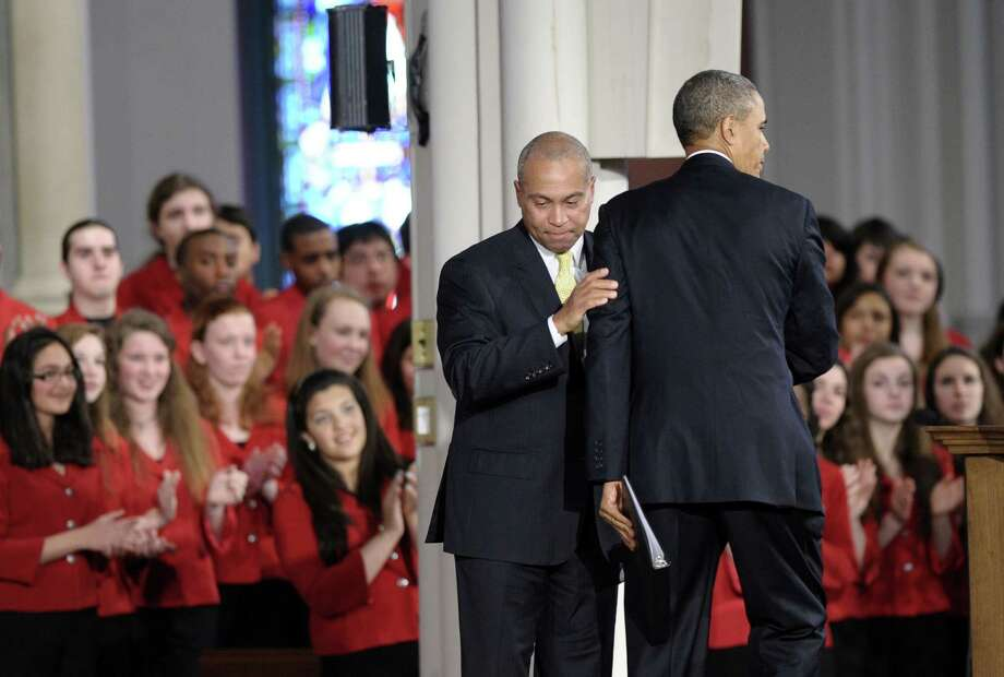 Massachusetts Gov. Deval Patrick hugs President Barack Obama as they attend an interfaith church service in Boston on Thursday. Photo: Susan Walsh / Associated Press