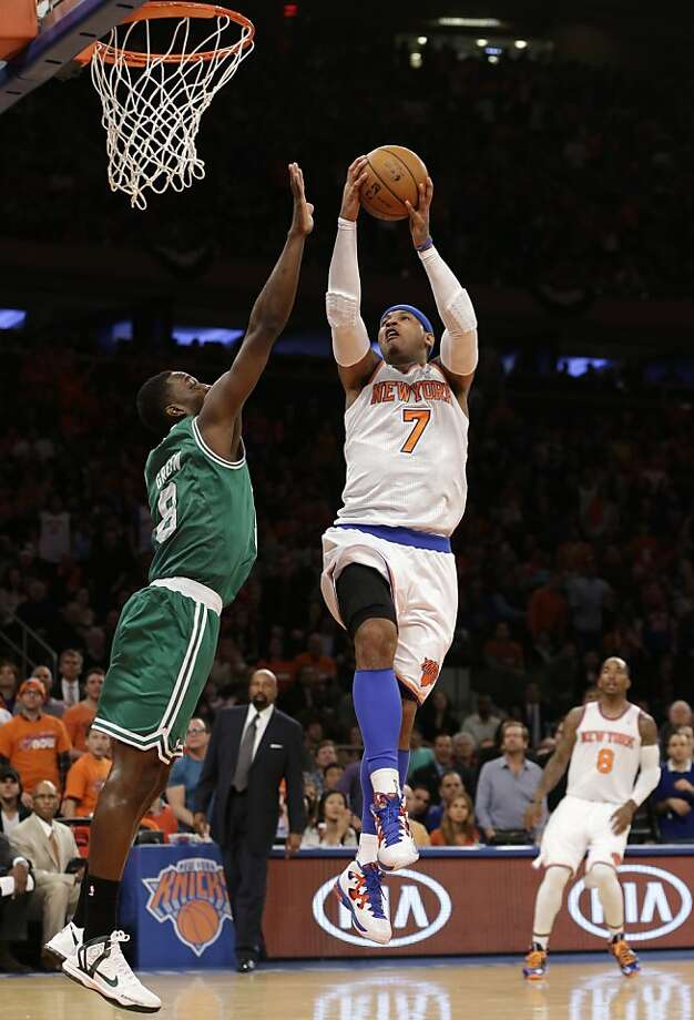 New York Knicks forward Carmelo Anthony (7) goes up for a layup as Boston Celtics forward Jeff Green (8) defends during the first half of Game 1 in the first round of the NBA basketball playoffs at Madison Square Garden in New York, Saturday, April 20, 2013.  (AP Photo/Kathy Willens) Photo: Kathy Willens, Associated Press