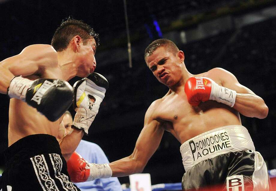 Raul Hidalgo, right, lands a punch on Ivan Morales during their flyweight bout in the Alamodome on Saturday, April 20, 2013. Photo: Billy Calzada, Express-News / San Antonio Express-News