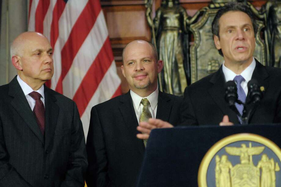 From left, Richard Iannuzzi, president of New York State United Teachers and Michael Mulgrew president of the United Federation of Teachers, look on as Governor Andrew Cuomo addresses those gathered during a press conference Thursday, Feb. 16, 2012, at the Capitol in Albany, N.Y.  The press conference was held to announce an agreement on a teacher evaluation system for the state.  (Paul Buckowski / Times Union) Photo: Paul Buckowski
