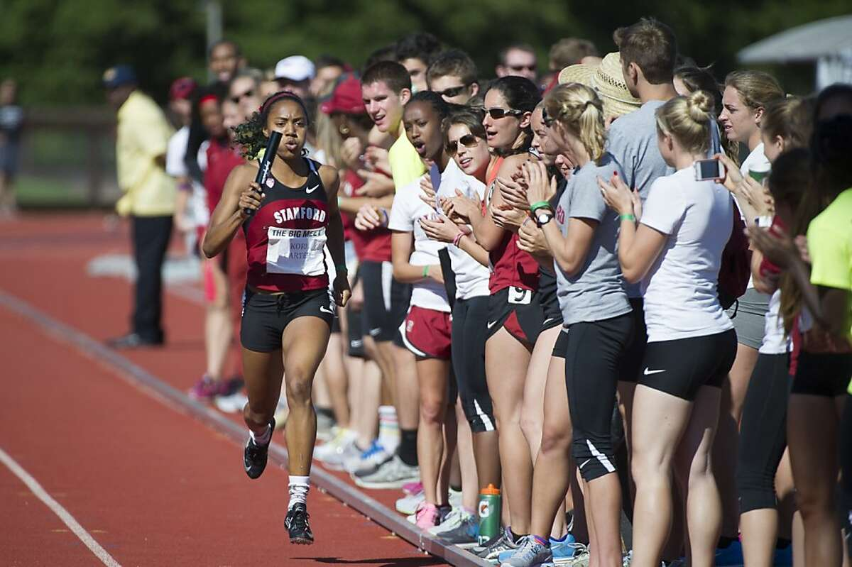 Cori Carter of Stanford crosses the finish line during the Women's 4x400 meter relay at the 118th Big Meet Cal vs Stanford at Stanford University in Stanford, Calif. on April 20,2013.