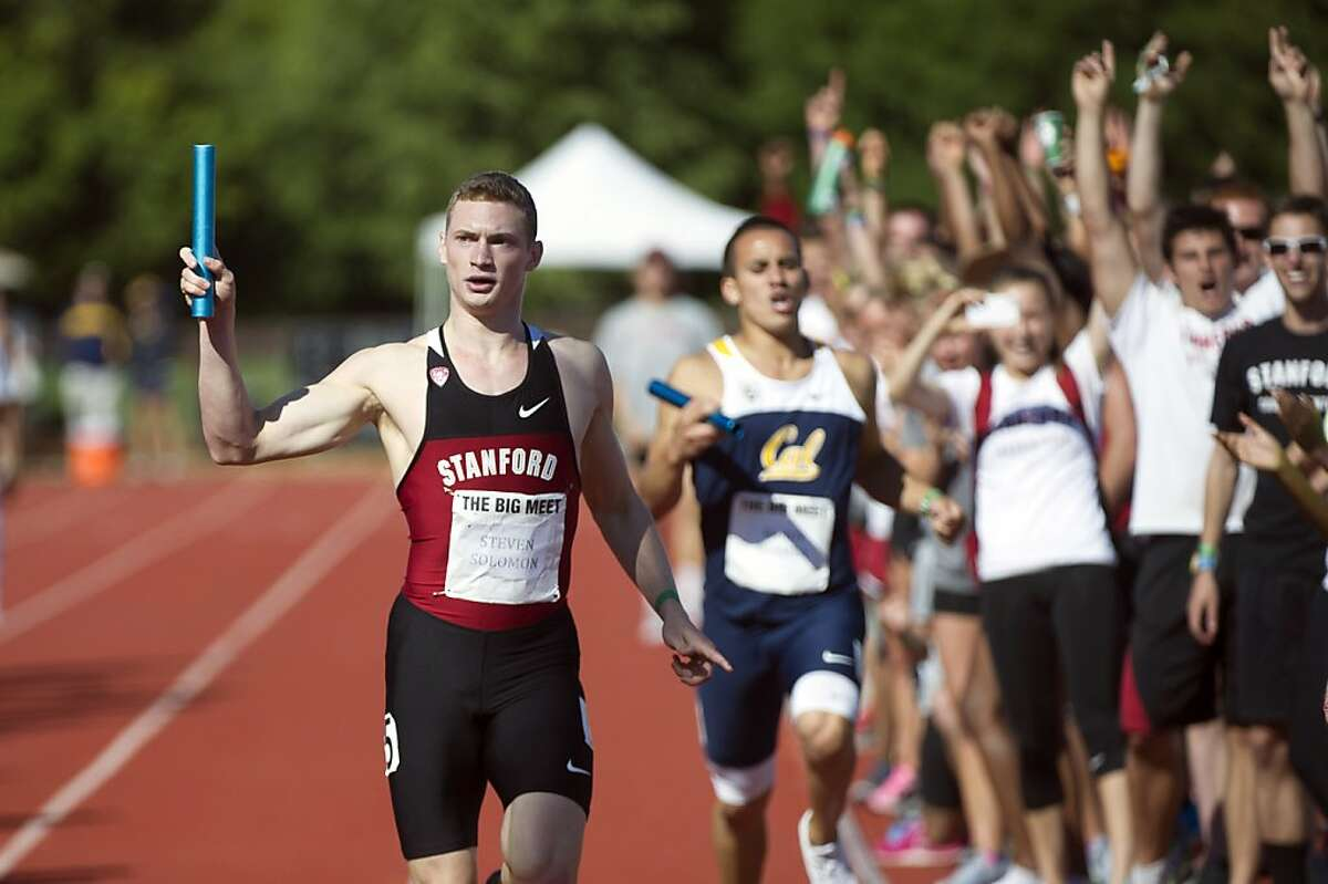 Stephen Solomon of Stanford. left crosses the finish line ahead of Randy Bermea of Cal during the Men's 4x100 meter relay during the 118th Big Meet Cal vs Stanford at Stanford University in Stanford, Calif. on April 20,2013.