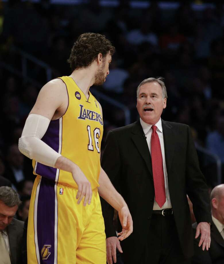 Coach Mike D'Antoni is new to the Lakers-Spurs playoff rivalry, but not to the Spurs in the playoffs. Two of his Suns teams were eliminated by them. Photo: Jae C. Hong / Associated Press