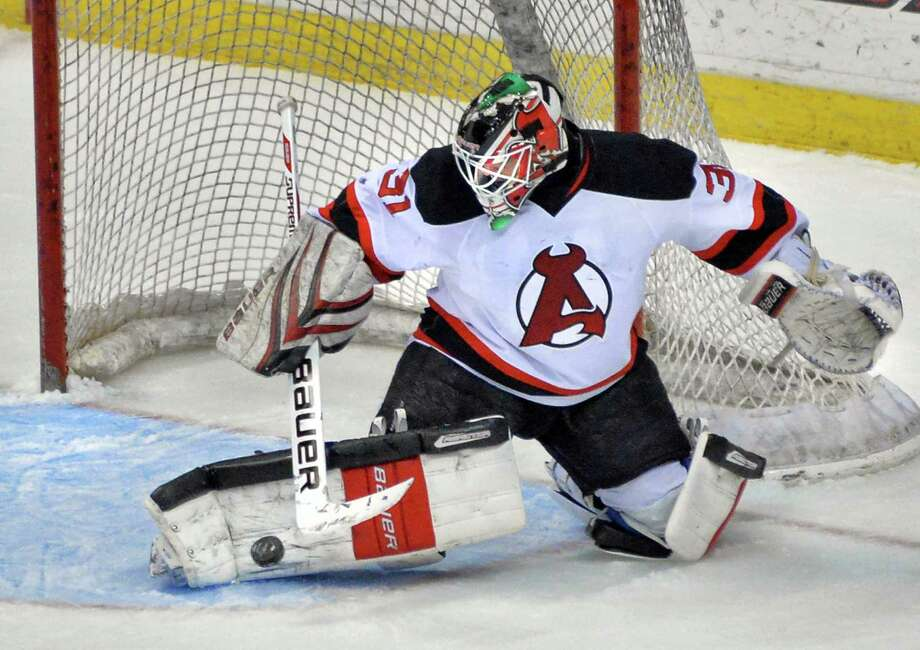 The Albany Devils goalie #31 Jeff Frazee stops a shot on goal in Saturday's game against the Norfolk Admirals at the Times Union Center in Albany, NY, April 20, 2013.   (John Carl D'Annibale / Times Union) Photo: John Carl D'Annibale / 00021748I