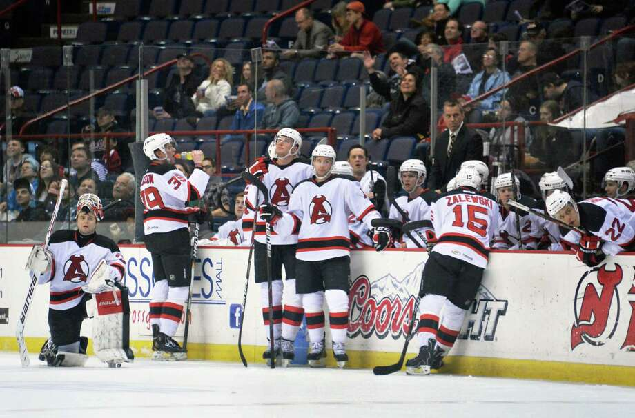 The Albany Devils during a time out in Saturday's game against the Norfolk Admirals at the Times Union Center in Albany, NY, April 20, 2013.   (John Carl D'Annibale / Times Union) Photo: John Carl D'Annibale / 00021748I