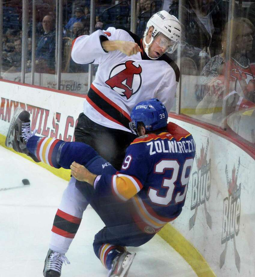 Albany Devils' #26 Mike Hoeffe, top, and Norfolk Admirals' #39 Harry Zolnierczyk duke it out during Saturday's game at the Times Union Center in Albany, NY, April 20, 2013.   (John Carl D'Annibale / Times Union) Photo: John Carl D'Annibale / 00021748I