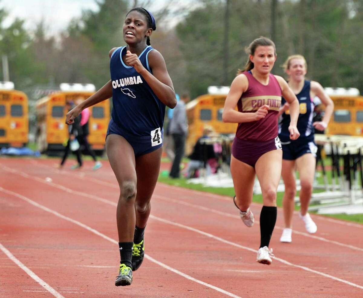 Columbia's Nastazja Johnston, left, finishes ahead of Colonie's Alicia Bousa to win the 400m during the Lady Eagle Invitational outdoor track meet at Bethlehem High School in Delmar, N.Y. Saturday April 20, 2013. (John Carl D'Annibale / Times Union)