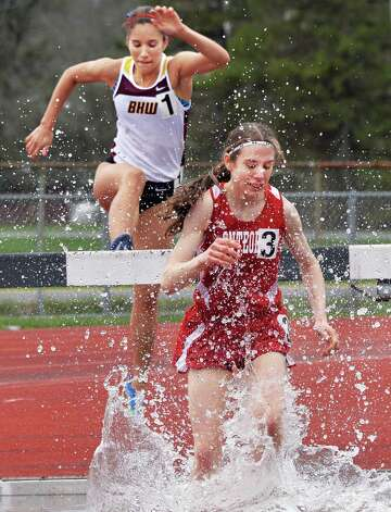 Berne Knox Westero's Courtney Tedeschi, left, falls behind Onteora's Julia Rubin-Armstrong in the 200m steeple chase during the Lady Eagle Invitational outdoor track meet at Bethlehem High School in Delmar, N.Y. Saturday April 20, 2013.   (John Carl D'Annibale / Times Union) Photo: John Carl D'Annibale / 00022023A