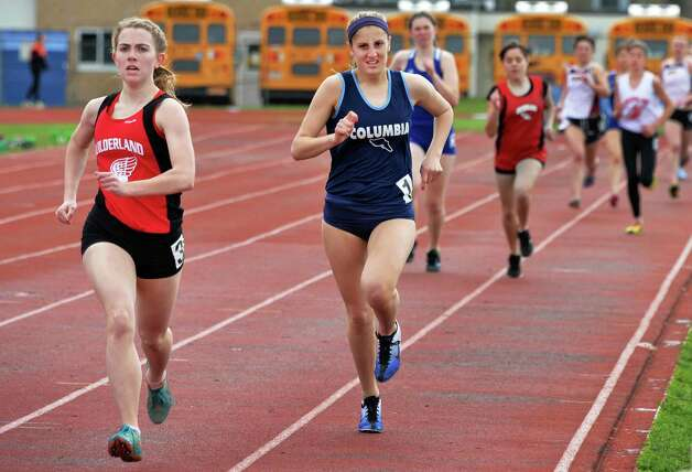 Guilderland's Amanda Stevens, left, beats Columbia's Nicolette Dimura in a 600m heat during the Lady Eagle Invitational outdoor track meet at Bethlehem High School in Delmar, N.Y. Saturday April 20, 2013.   (John Carl D'Annibale / Times Union) Photo: John Carl D'Annibale / 00022023A