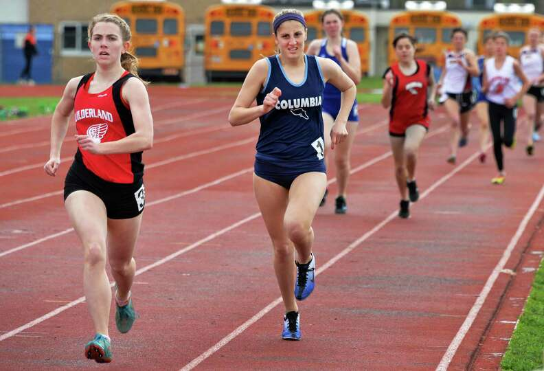 Guilderland's Amanda Stevens, left, beats Columbia's Nicolette Dimura in a 600m heat during the Lady