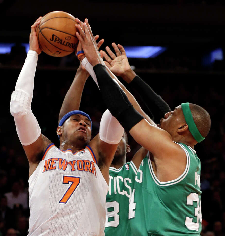 New York Knicks forward Carmelo Anthony (7) fends off Boston Celtics guard Jason Terry (8) and forward Paul Pierce, right, during the first half of Game 1 in the first round of the NBA basketball playoffs at Madison Square Garden in New York, Saturday, April 20, 2013.  (AP Photo/Kathy Willens) Photo: Kathy Willens