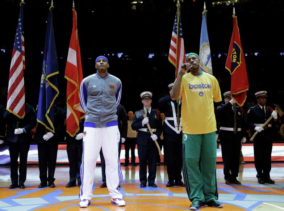 New York Knicks forward Carmelo Anthony, left, listens as Boston Celtics forward Paul Pierce speaks about the Boston Marathon bombings in front of color guards from New York and Boston  before Game 1 in the first round of the NBA basketball playoffs at Madison Square Garden in New York, Saturday, April 20, 2013.  (AP Photo/Kathy Willens) Photo: Kathy Willens
