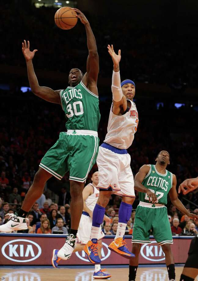 Boston Celtics forward Brandon Bass (30) grabs the ball in front of New York Knicks forward Kenyon Martin (3) during the first half of Game 1 in the first round of the NBA basketball playoffs at Madison Square Garden in New York, Saturday, April 20, 2013.  (AP Photo/Kathy Willens) Photo: Kathy Willens