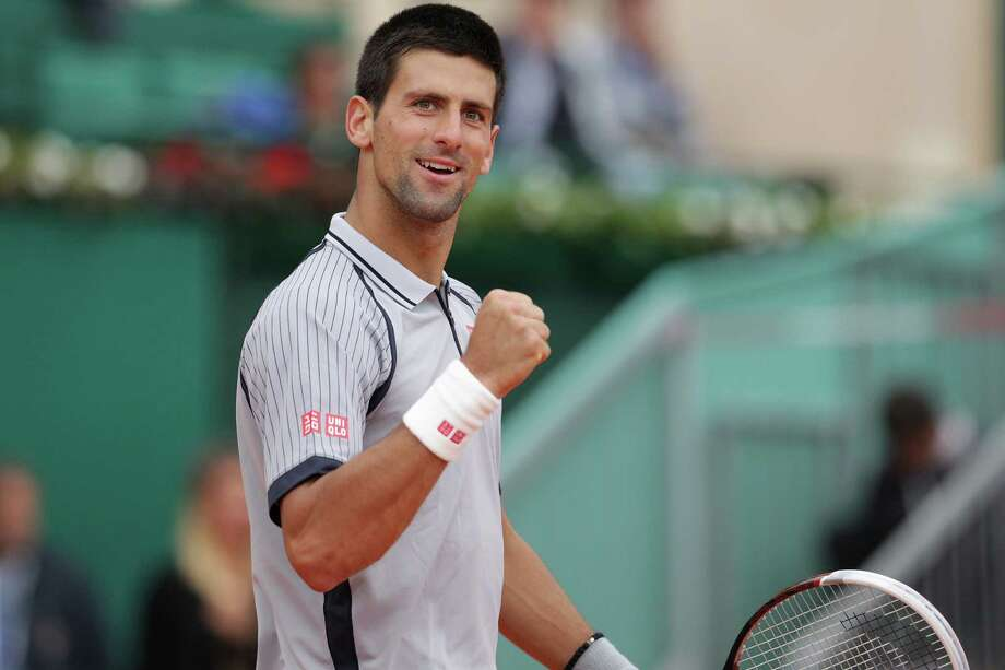 Serbia's Novak Djokovic celebrates after winning his match against Italian's Fabio Fognini at the Monte-Carlo ATP Masters Series Tournament tennis on April 20, 2013 in Monaco. AFP PHOTO / JEAN CHRISTOPHE MAGNENETJEAN CHRISTOPHE MAGNENET/AFP/Getty Images Photo: JEAN CHRISTOPHE MAGNENET