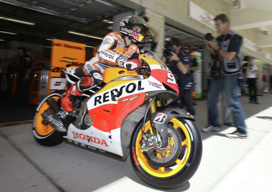 Pole winner Marc Marquez leaves his pit during qualifying for the MotoGP of the Americas race in Austin on Saturday. He edged Honda teammate Dani Pedrosa by 0.254 seconds. Photo: Tony Gutierrez / Associated Press